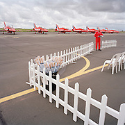 Ground commentator pilot of the Red Arrows, Britain's RAF aerobatic team readies himself before a public display.