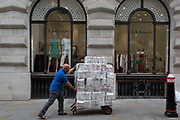A trolley of toilet rolls are pushed by a sanitation supplies delivery man in the City of London, the capitals Financial district, on 4th June 2018, in London, England.