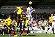 Leeds United striker Chris Wood (9) wins a header during the EFL Sky Bet Championship match between Burton Albion and Leeds United at the Pirelli Stadium, Burton upon Trent, England on 22 April 2017. Photo by Richard Holmes.