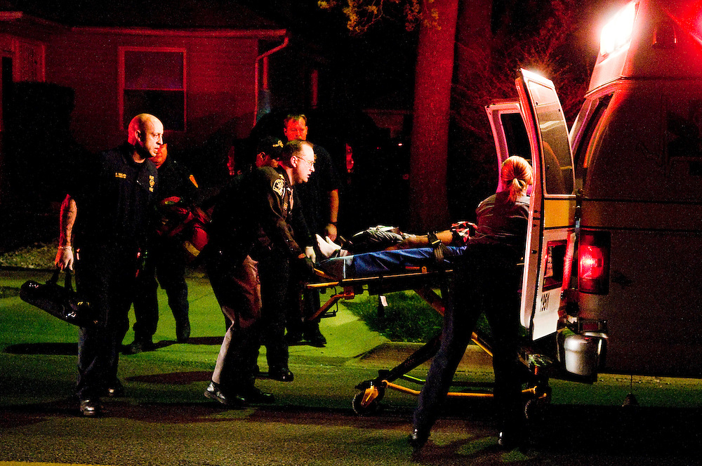 A victim is placed inside an ambulance at the scene of a shooting on Flushing Road near Dupont Street in Flint.