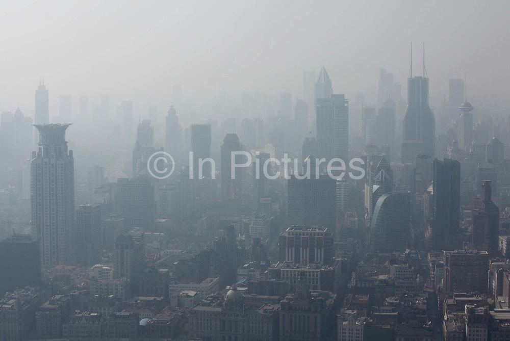 A view of the city's crowded skyline through haze and pollution in Shanghai, China on 23 November 2009.