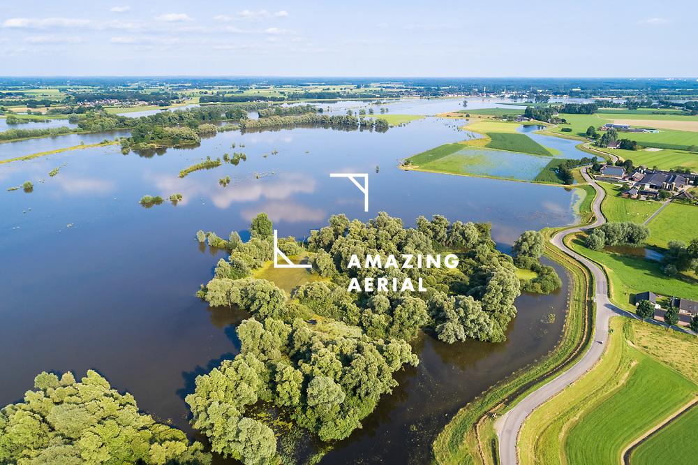 Aerial view of flooded floodplains between river IJssel and a dike during high water in summer, Welsumer Waarden, Gelderland and Overijssel, The Netherlands.