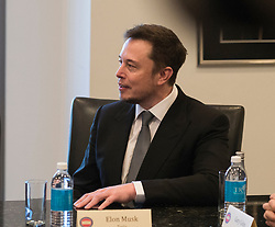 File photo - Tesla CEO Elon Musk is seen at a meeting of technology leaders in the Trump Organization conference room at Trump Tower in New York, NY, USA on December 14, 2016. - Tech entrepreneur Elon Musk has revealed he has Asperger's syndrome while appearing on the US comedy sketch series Saturday Night Live (SNL). Photo by Albin Lohr-Jones / Pool via CNP