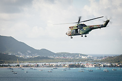 Hand out photo - As part of Operation Resilience, the Dixmude Amphibious Helicopter Carrier (PHA) Dixmude will disembark by Puma helicopters from food and medical cargo bound for Saint Martin, France on April 17, 2020. Operation Resilience is the armed forces' contribution to the interministerial commitment against the spread of Covid-19. It focuses on aid and support for populations as well as support for public services to deal with this epidemic, in metropolitan France and overseas, in the fields of health, logistics and protection. Photo by Christophe Hugé/EMA/Marine Nationale/ABACAPRESS.COM