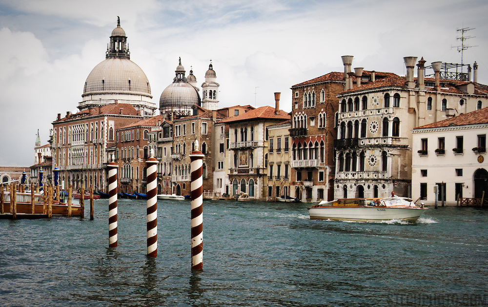 A view of the the Grand Canal and Basilica of St Mary of Health in the Italian city of Venice.<br /> <br /> + ART PRINTS +<br /> To order prints or cards of this image, visit:<br /> http://greg-stechishin.artistwebsites.com/featured/grand-canal-greg-stechishin.html