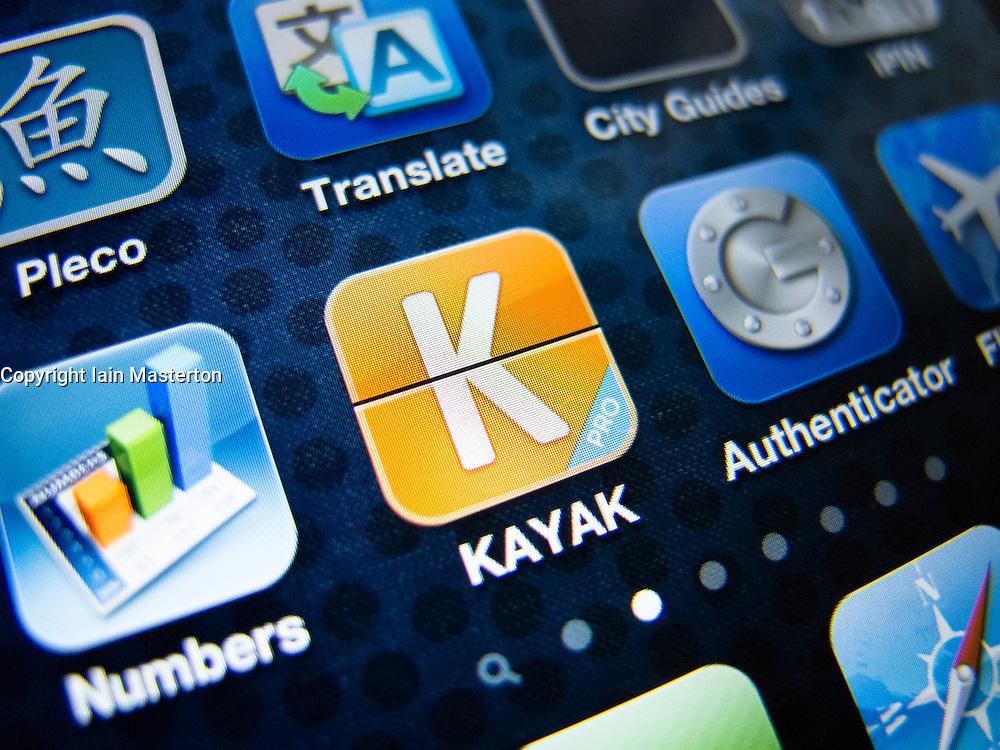 detail of iPhone 4G screen showing  Kayak online travel  booking app
