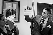 21 OCTOBER 2013 - PHOENIX, AZ: JOSE BETO SOTO, field director of Citizens for a Better Arizona, and other DREAM Act supporters talks about the actions of Arizona Attorney General Tom Horne (whose portrait is hanging on the wall behind them) during a protest in the office of the Attorney General. The DREAMers are protesting the decision by Attorney General Horne to sue the Maricopa County Community College District to force the district to charge in-state tuition to the young people who qualify for the federal government deferred-action program.   PHOTO BY JACK KURTZ
