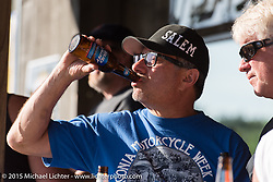 AJ at the Broken Spoke during Laconia Motorcycle Week. Laconia, NH, USA. June 13, 2015.  Photography ©2015 Michael Lichter.