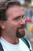 Bearded man age 27 looking happily into distance.  St Paul  Minnesota USA