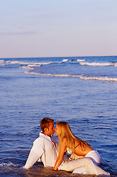romantic couple enjoying time together in the ocean in East Hampton, NY