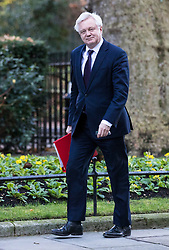 © Licensed to London News Pictures. 18/12/2017. London, UK. Secretary of State for Exiting the European Union David Davis arrives on Downing Street for a special Cabinet meeting in which ministers are expected to discuss the Brexit end deal. Photo credit: Rob Pinney/LNP