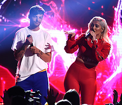 LOS ANGELES - AUGUST 13:  Louis Tomlinson (L) and Bebe Rexha perform onstage at FOX's 'Teen Choice 2017' at the Galen Center on August 13, 2017 in Los Angeles, California. (Photo by Frank Micelotta/FOX/PictureGroup) *** Please Use Credit from Credit Field ***