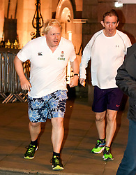 © Licensed to London News Pictures. 02/10/2017. Manchester, UK. Foreign secretary BORIS JOHNSON seen running with Sun Newspaper editor TONY GALLAGHER (right)on the morning of the second day of the Conservative Party Conference. The four day event is expected to focus heavily on Brexit, with the British prime minister hoping to dampen rumours of a leadership challenge. Photo credit: Ben Cawthra/LNP