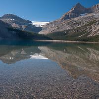 Portal Peak & The Wapta Icefield reflect in Bow Lake in Banff National Park, Alberta, Canada.