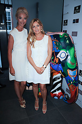 Left to right, TAMARA BECKWITH and AMANDA KYME at a private view of Sacha Jafri's paintings entitled 'London to India' held in aid of The Elephant Family charity at 23 Macklin Street, Covent Garden, London on 3rd June 2010.