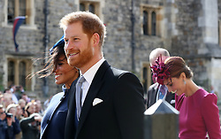 The Duchess of Sussex, the Duke of Sussex, and the Duchess of Cambridge after the wedding of Princess Eugenie to Jack Brooksbank at St George's Chapel in Windsor Castle.