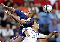 ◊Copyright:<br />GEPA pictures<br />◊Photographer:<br />Dominic Ebenbichler<br />◊Name:<br />Trezeguet<br />◊Rubric:<br />Sport<br />◊Type:<br />Fussball<br />◊Event:<br />Euro 2004, Europameisterschaft, EM, Frankreich vs Griechenland, FRA vs GRE<br />◊Site:<br />Lissabon, Portugal<br />◊Date:<br />25/06/04<br />◊Description:<br />David Trezeguet (FRA), Pangiotis Fyssas (GRE)<br />◊Archive:<br />DCSDE-250604706<br />◊RegDate:<br />25.06.2004<br />◊Note:<br />8 MB - RL/ RL -  Gemaess UEFA keine Nutzungsrechte für Mobiltelefone, PDAs und MMS- Dienste - no MOBILE - no PDAs - no MMS