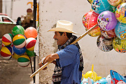 03 APRIL 2004 - SAN MIGUEL DE ALLENDE, GUANAJUATO, MEXICO: A balloon and toy vendor works in the market in San Miguel de Allende, Mexico. San Miguel, which was founded in the 1600s, is one of Mexico's premier colonial cities. It has very strict zoning and building codes meant to preserve the historic nature of the city center. About 7,500 US citizens, mostly retirees, live in San Miguel. PHOTO BY JACK KURTZ