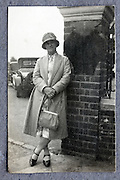 adult female person waiting by the car parking 1920s England