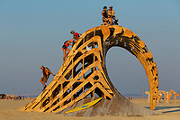 Cruz the Wave by: Santa Cruz Burners year: 2014<br /> <br /> Cruz the Wave is a large wooden curling surf wave that will rise 18′ out of the playa. Playa colored during the day, it will be lit with thousands of programmable LEDs at night. Contact: info@cruzthewave.org