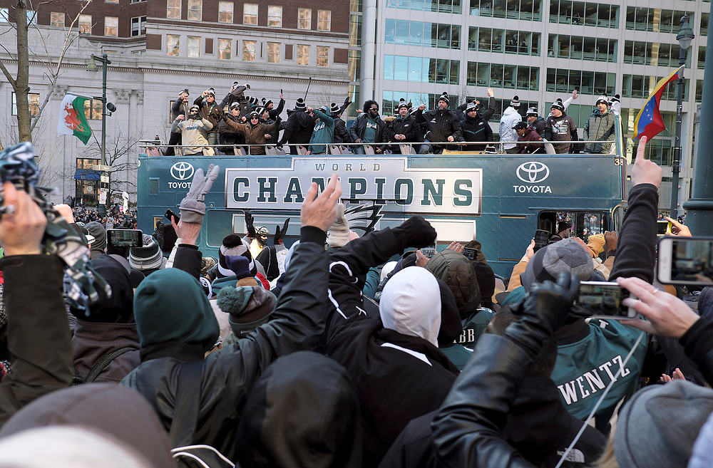 Eagles fans cheer buses containing members of the Philadelphia Eagles organization as they celebrate their Super Bowl LII win during a parade Feb. 8, 2018, in front of millions gathered in downtown Philadelphia, Pennsylvania. (Photo by Matt Smith)