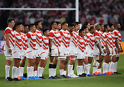The Japan teams line up for the anthems before the Pool A match between Japan and Russia at the Tokyo Stadium, Tokyo, Japan. Picture date: Friday September 20, 2019. See PA story RUGBYU Japan. Photo credit should read: Ashley Western/PA Wire. RESTRICTIONS: Editorial use only. Strictly no commercial use or association. Still image use only. Use implies acceptance of RWC 2019 T&Cs (in particular Section 5 of RWC 2019 T&Cs) at: https://bit.ly/2knOId6