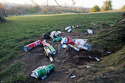 © Licensed to London News Pictures. 18/04/2021. London, UK. Litter left on Primrose Hill in North London, despite the park being closed from 10pm last night. A curfew has been put in to place at the park over the weekend  to prevent large gatherings in the evening. Photo credit: Ben Cawthra/LNP