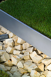 Stone bricks and metal edging to lawn. In the Grove Garden. Design: Christopher Bradley-Hole - Chelsea 2005