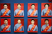 Photographs of model workers adorn a wall at the China State Shipbuilding Corp.'s (CSSC) Longxue Shipyard in Guangzhou, Guangdong Province, China, on Sunday, Nov. 13, 2011. China is the world's biggest shipbuilder, however recent economic downturns have caused a glut in supplies.