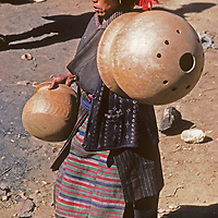 A Sherpa woman (Sherpani) carries home big clay pots she has bought at the Saturday market in Namche Bazaar, the leading Sherpa town in Nepal's Himalaya.