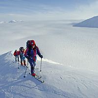 Spitsbergen Island, Svalbard, Norway.Expedition skiers climb Nemtinov Peak above the Tunabreen Glacier.