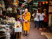 28 AUGUST 2015 - BANGKOK, THAILAND: A Buddhist monk walks through the Chinatown section of Bangkok.      PHOTO BY JACK KURTZ