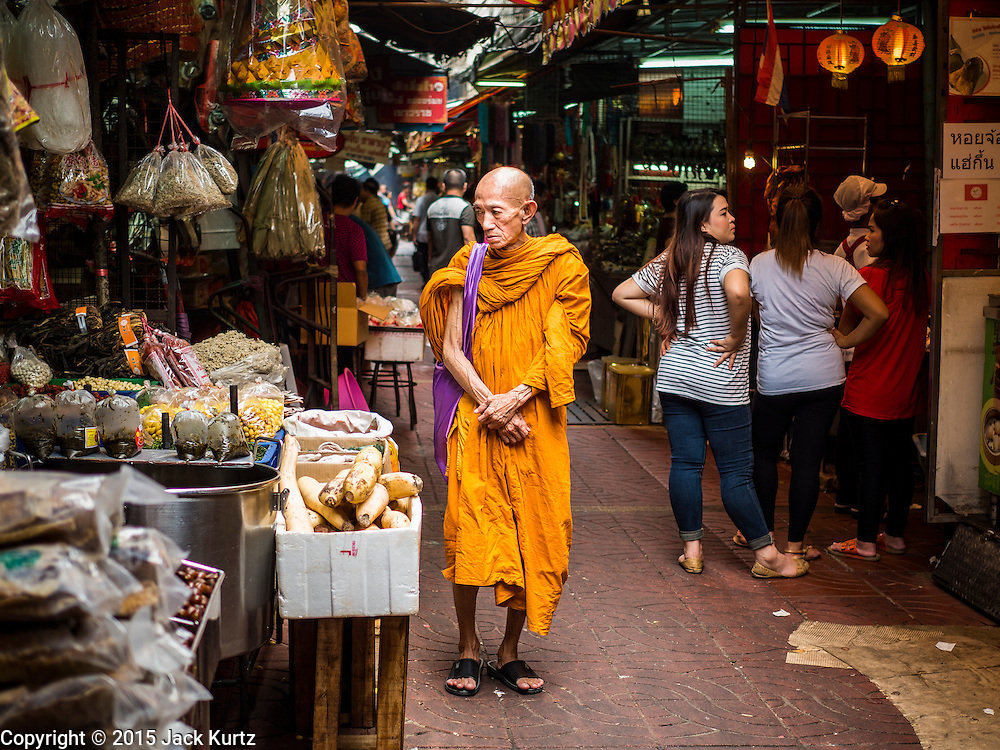 28 AUGUST 2015 - BANGKOK, THAILAND: A Buddhist monk walks through the Chinatown section of Bangkok.      PHOTO BY JACK KURTZ