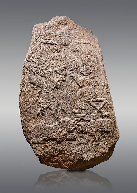 """Aslantepe Hittite relief sculpted Stele. Limestone, Aslantepe, Malatya, 1200-700 B.C. Anatolian Civilisations Museum, Ankara, Turkey.<br /> <br /> Under the winged sun disk, is a god standing on a lion and across the god is a sitting goddess. The hieroglyphs reads """"Karhuhas, the stag god"""" for the god, and """"Kubaba"""" for the Goddess. <br /> <br /> Against a gray background. .<br /> <br /> If you prefer to buy from our ALAMY STOCK LIBRARY page at https://www.alamy.com/portfolio/paul-williams-funkystock/hittite-art-antiquities.html . Type - Aslantepe - in LOWER SEARCH WITHIN GALLERY box. Refine search by adding background colour, place, museum etc.<br /> <br /> Visit our HITTITE PHOTO COLLECTIONS for more photos to download or buy as wall art prints https://funkystock.photoshelter.com/gallery-collection/The-Hittites-Art-Artefacts-Antiquities-Historic-Sites-Pictures-Images-of/C0000NUBSMhSc3Oo"""