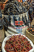 Dried red hot cayenne chili and pasilla pepper at Benito Juarez market in Oaxaca, Mexico.