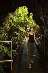woman visitor exploring Thurston Lava Tube or Nahuku, Hawaii Volcanoes National Park, Kilauea, Big Island, Hawaii, USA, MR