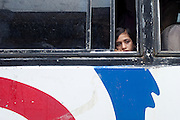A girl is looking out of the window of a bus travelling in Bhopal, Madhya Pradesh, India, near the abandoned Union Carbide (now DOW Chemical) industrial complex, site of the infamous 1984 gas tragedy. The poisonous cloud that enveloped Bhopal left everlasting consequences that today continue to consume people's lives.