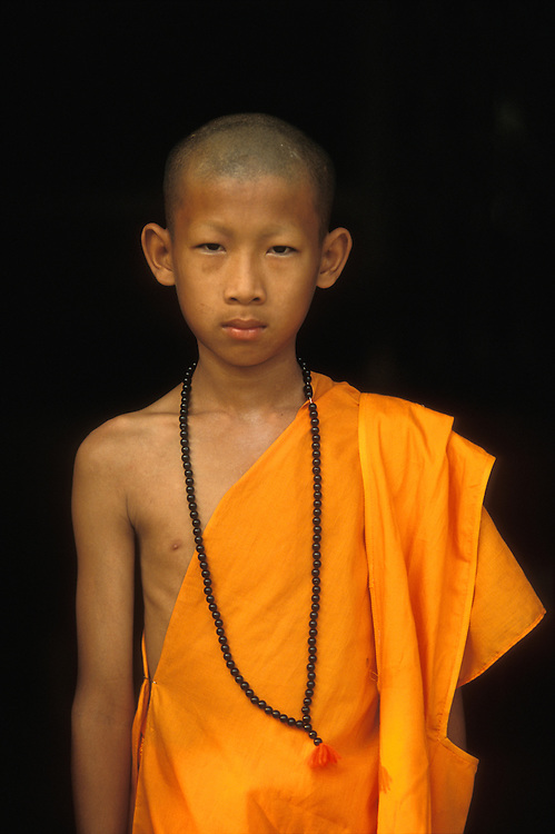 A  young novice monk shortly after he has gone through the Poy Sang Long, the ordination of novice monks, in Mae Hong Son, Thailand. April 2003.