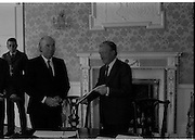 Charles Haughey Receives Seal Of Office.   (T3)..1989..12.07.1989..07.12.1989..12th July 1989..After winning the General Election and having been elected Taoiseach by a majority in Dail Eireann, Charles Haughey went to Aras an Uachtarain to acept the seal of office. The seal of office was granted by President Patrick Hillery...The President and Taoiseach pose for pictures after the official signing.