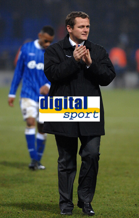 Photo: Ashley Pickering/Sportsbeat Images.<br /> Ipswich Town v West Bromwich Albion. Coca Cola Championship. 01/01/2008.<br /> Ipswich manager Jim Magilton leaves the pitch a happy man after his side beat top of the table West Brom 2-0