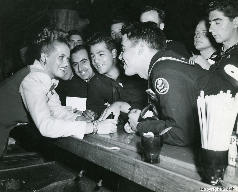 1945 Janis Paige signs autographs at the Hollywood Canteen