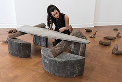 """© Licensed to London News Pictures. 17/04/2018. LONDON, UK. A staff member """"Hirsch (Stag)"""", 1958/1982, a teak wood and wooden ironing board that belonged to the artist's mother, at the preview of """"Joseph Beuys: Utopia at the Stag Monuments"""", at the Galerie Thaddaeus Ropac in Dover Street.  The retrospective is the most important UK exhibition of Beuys' work in over a decade, presenting major sculptures and rarely seen works from 1947 to 1985, and runs from 18 April to 16 June.  Photo credit: Stephen Chung/LNP"""