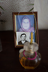 A photograph of family members sits on the mantlepiece at Svetlana and Ivan Vorobyeva's apartment in Debaltsevo.