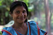 Pastora Quintero, Ngäbe woman and member of COCABO, helps prepare lunch for a co-op members meeting. COCABO: Valle de Agua Arriba, Almirante, Changuinola, Bocas del Toro, Panamá. September 1, 2012.