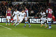 Federico Fernandez of Swansea city (c) celebrates with his teammates after he scores his teams 1st goal.Barclays Premier league match, Swansea city v Aston Villa at the Liberty Stadium in Swansea, South Wales on Saturday 19th March 2016.<br /> pic by  Andrew Orchard, Andrew Orchard sports photography.