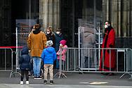 Coronavirus / Covid 19 outbreak, March18th. 2021. supervisory staff control the entrance to the  <br /> cathedral, Cologne, Germany.<br /> <br /> Coronavirus / Covid 19 Krise, 18. Maerz 2021. Domschweizer kontrollieren den Einlass in den Koelner Dom, Koeln, Deutschland.