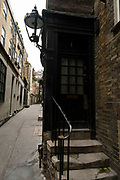 Goodwins Court, a narrow alley in Covent Garden with houses dating from around 1690 on 25th May 2021 in London, United Kingdom. This alleyway is rumoured to be the inspiration for Harry Potters Diagon Alley.