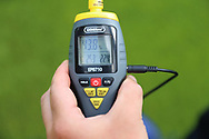 Taking the pitch temperature during the Pre-Season Friendly match between AFC Wimbledon and Queens Park Rangers at the Cherry Red Records Stadium, Kingston, England on 14 July 2018. Picture by Matthew Redman.
