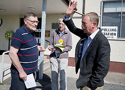 Liberal Democrat leader Tim Farron (right) speaks to voters at the Allithwaite Community Centre in Allithwaite, Cumbria, as voters go to the polls in local elections across the country.