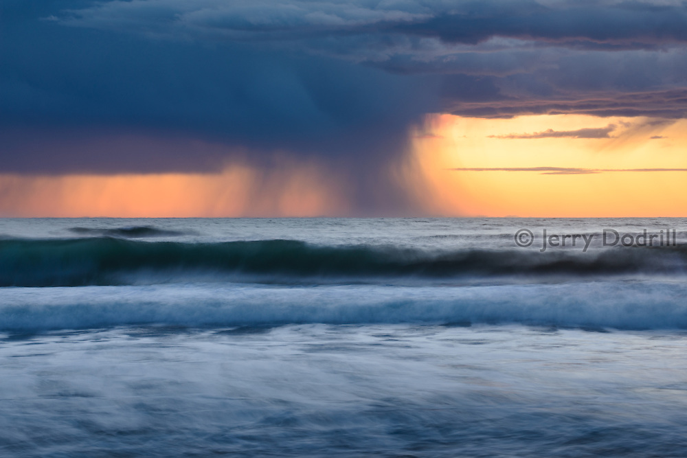 A winter storm cell moves across the Pacific Ocean off the Sonoma Coast at Salmon Creek Beach, Bodega Bay, California